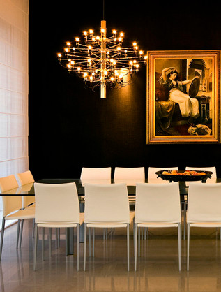 Be bold! This black and gold Tel Aviv dining room appears both modern and upscale.