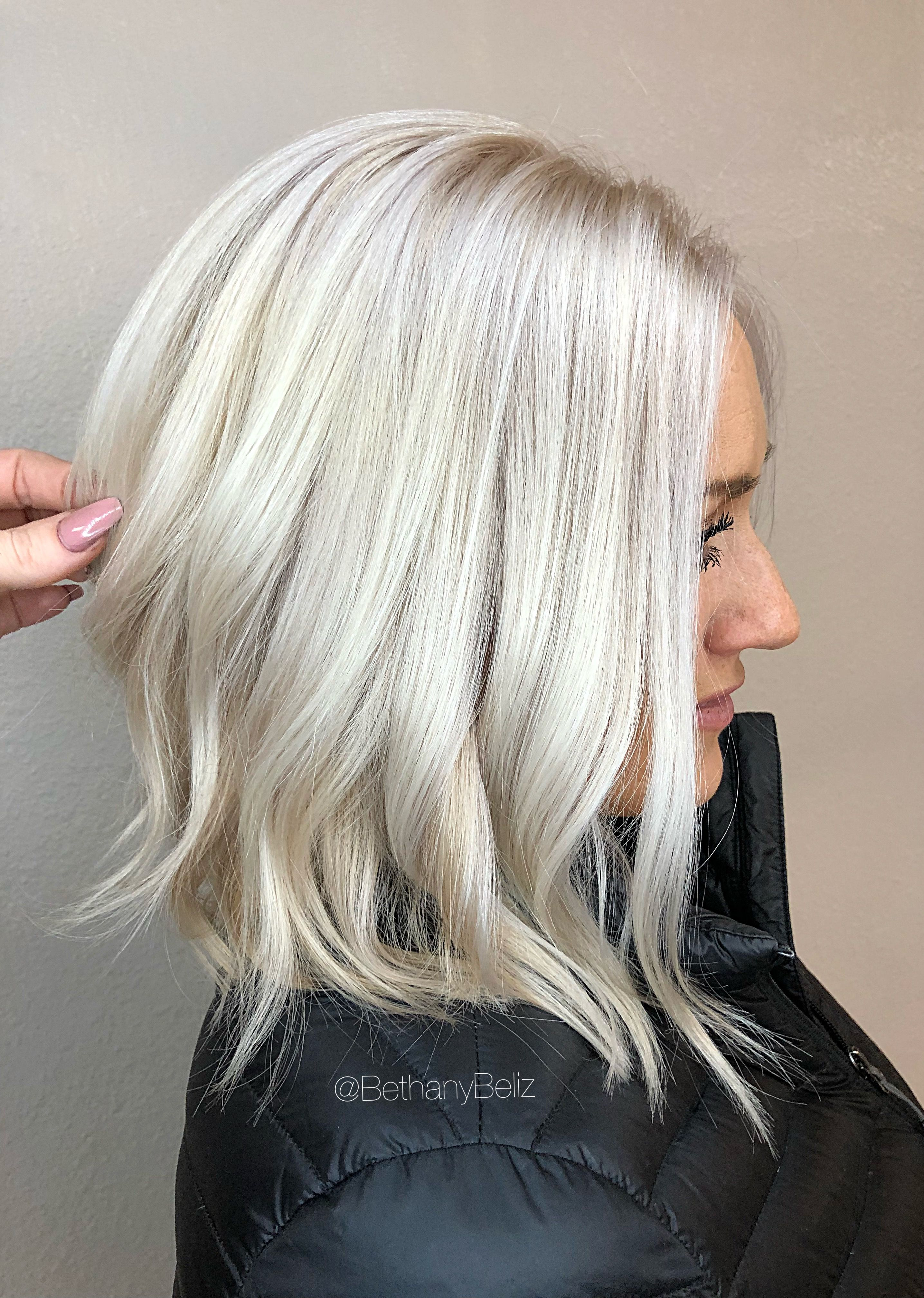 platinum blonde bleach and tone aline lob haircut | the