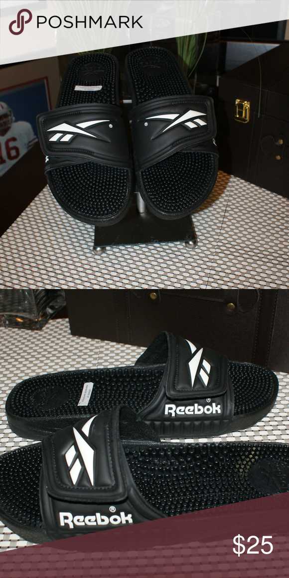 447fd1096 Reebok Slides-Flip Flops....Men s size 11 M...NWT Reebok Slides-Flip  Flops....Men s size 11 M...NWT....BRAND NEW never worn....Color  Black with  ...