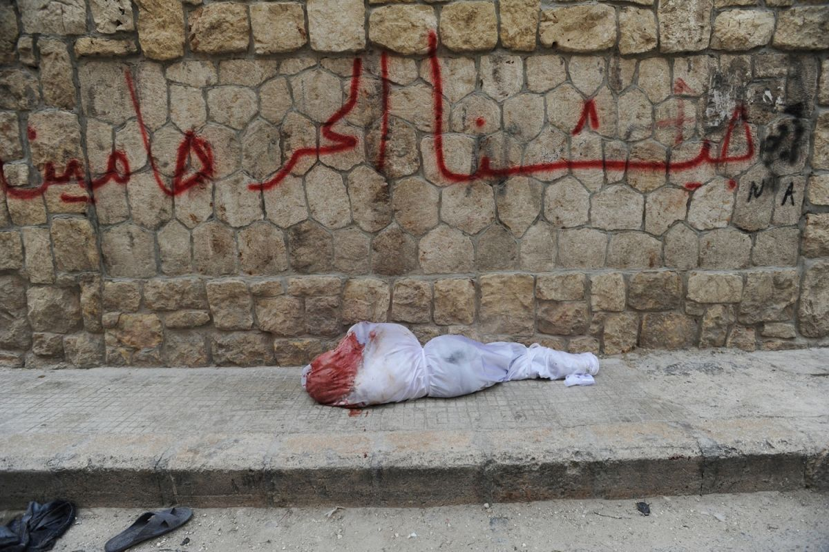 July 29, 2012. A body wrapped in a bloody shroud lies on the sidewalk as shelling continues on the second day of a Syrian government military offensive against rebels of the Free Syrian Army (FSA) in Aleppo, Syria.    Read more: http://lightbox.time.com/2012/08/03/pictures-of-the-week-july-27-august-3/#ixzz243a8eP26