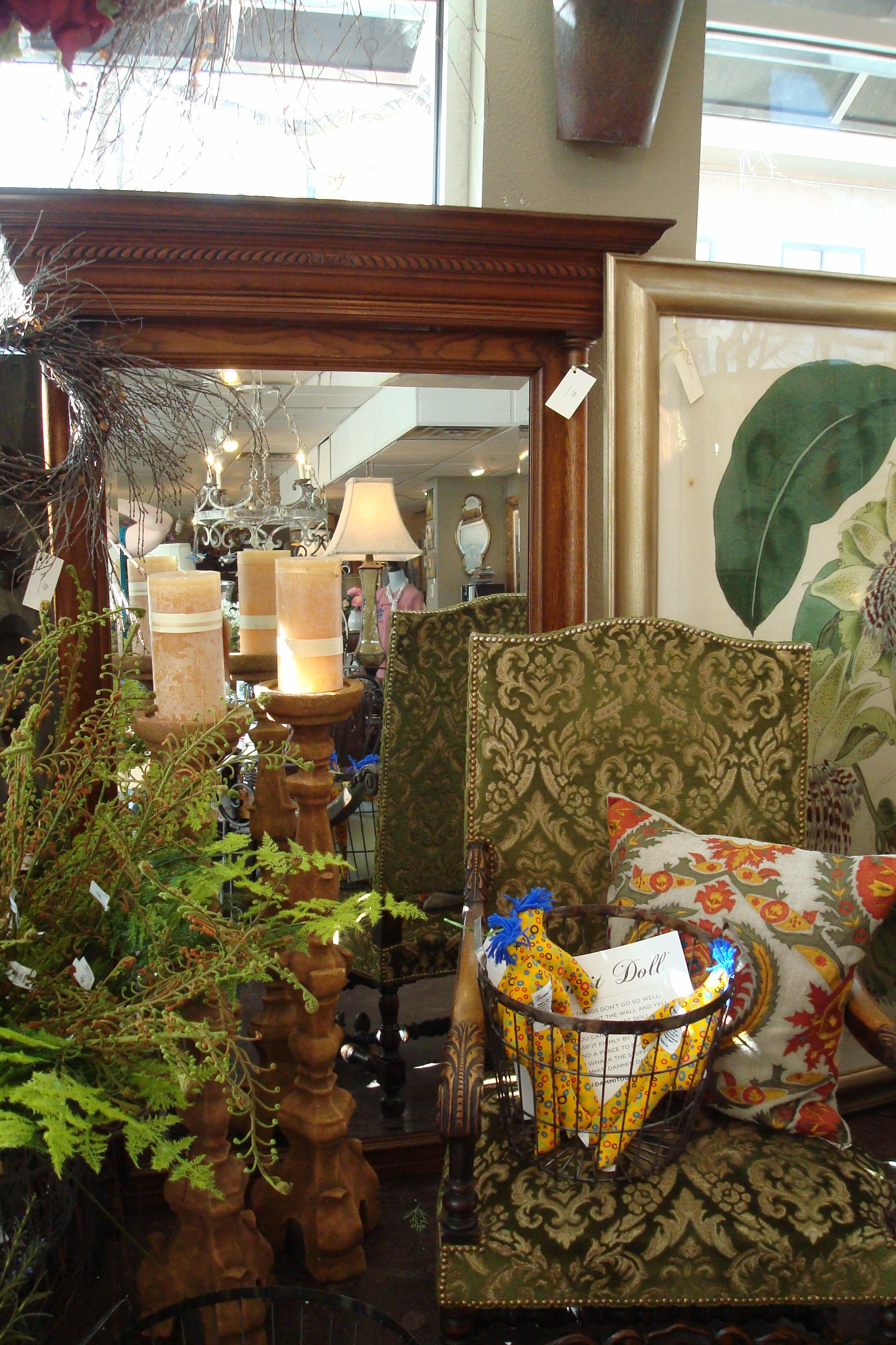 French antique chair with beautiful green cut velvet upholstery in front of Antique mirror