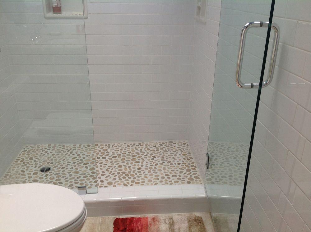 Large Java Tan Pebble Tile Shower Floor With White Brick Tile
