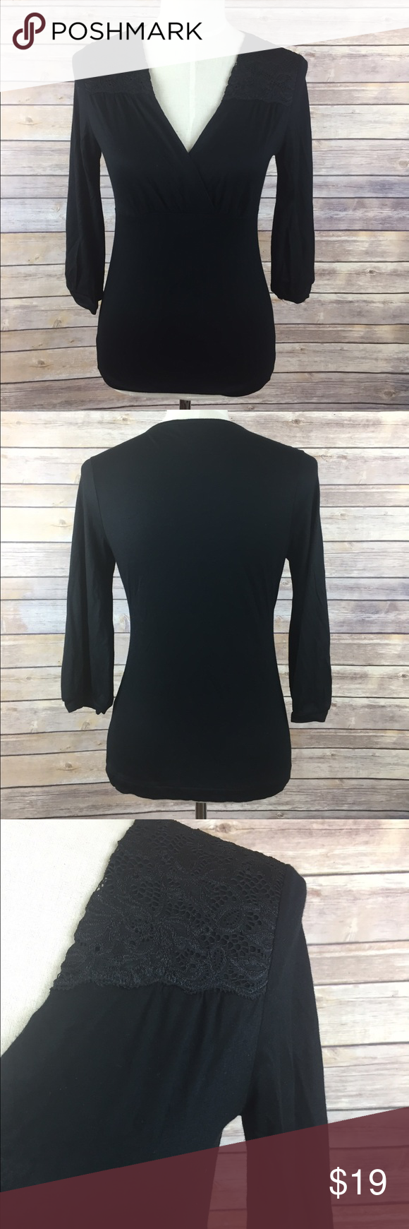 Banana Republic 3/4 Sleeve Top Solid black with a y-neck and Lace shoulder detail. Banana Republic Tops Blouses