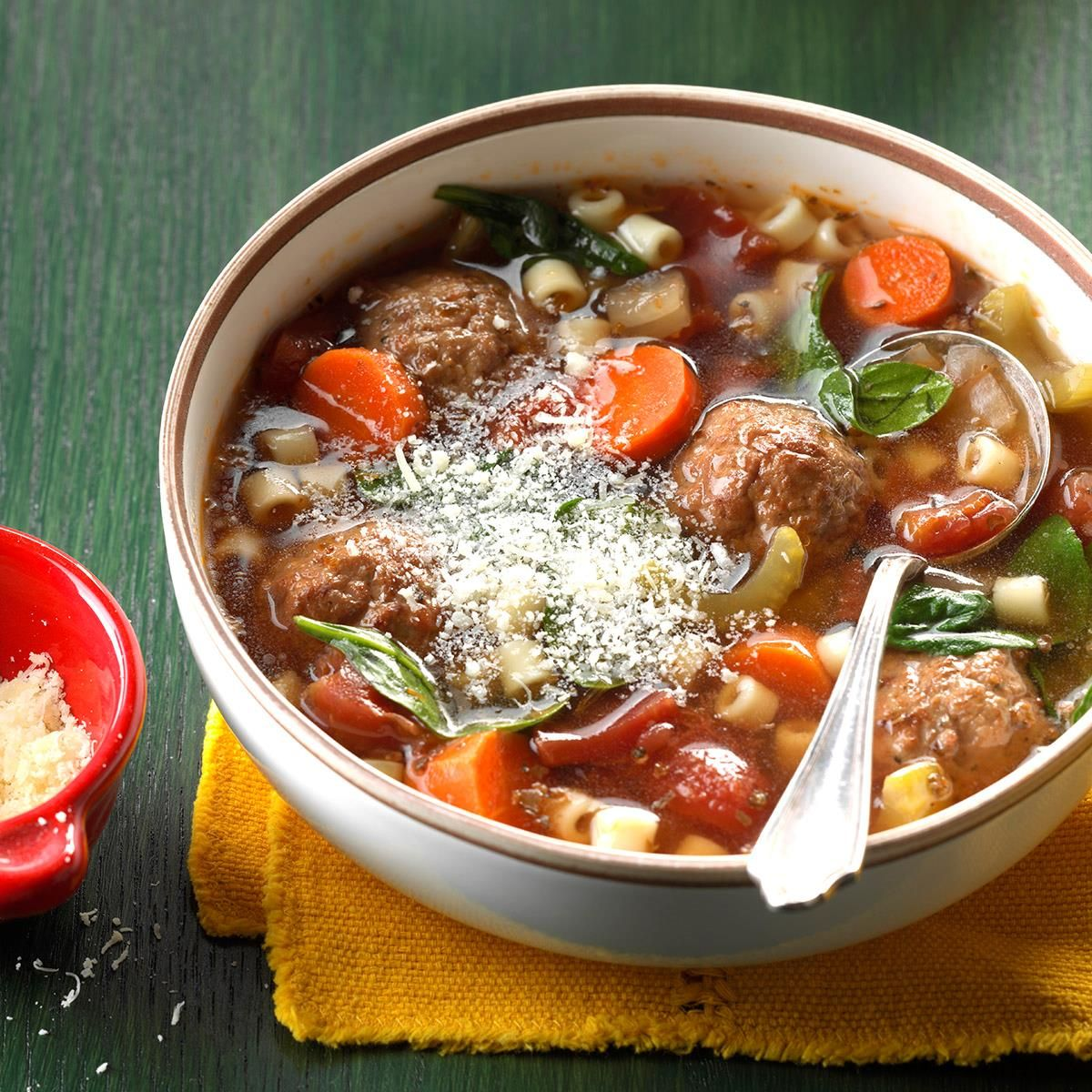 Cooking soup with meatballs and pasta