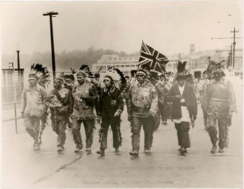 "Haudenosaunee delegation crosses the U.S.-Canada border at Niagara Falls on July 14, 1928. It is the ""Return of Border Crossing Privileges to all Indians First Annual Celebration."""
