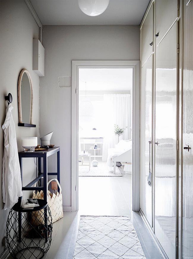 entrada-apartamento-gris-y-blanco-decoración-espacios-pequeños