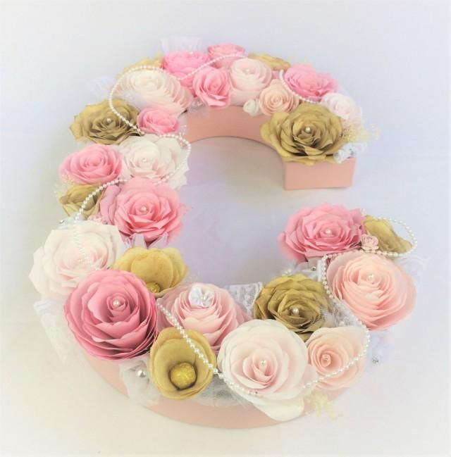 The delicate pearls draping the hand created paper coffee filter flowers create elegance. The roses, peonies and accent flowers are in lovely shades of pinks, blush and gold. I have added in tufts of dried baby's breath, delicate lace, tulle and ribbon flowers for even more beauty.