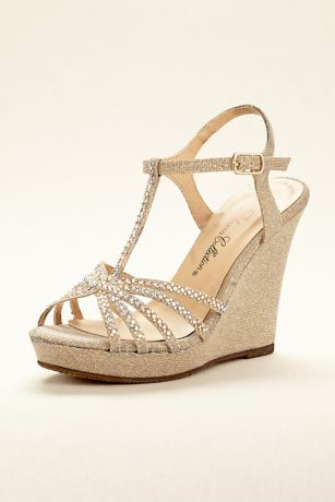 """Add a glamorous touch to your evening attire with these sparkling t-strap wedge sandals!  Features crystal embellished straps and buckle closure for a secure fit.  Heel height: 4 1/2""""  Fully lined.  Imported."""