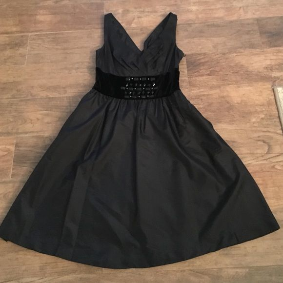 Dress perfect for the holidays! V neck and back dress. A line bottom with side zipper and pockets! Who doesn't love pockets in their dress! Velour beaded area under bust. I'm 5'5 dress comes down to my mid-knees. Like new, I wore it once to a corporate Christmas Party Nine West Dresses Asymmetrical