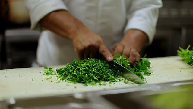 MS Prep cook chopping cilantro / Truxton\u0027s, CA, United States