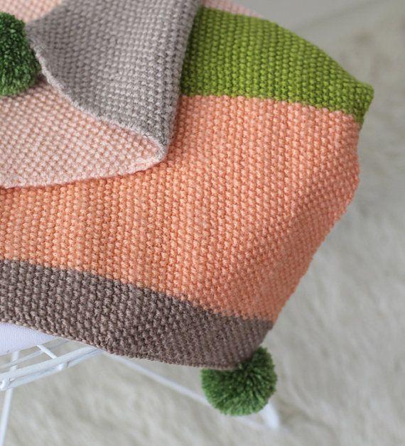 Couverture de bébé avec pompon