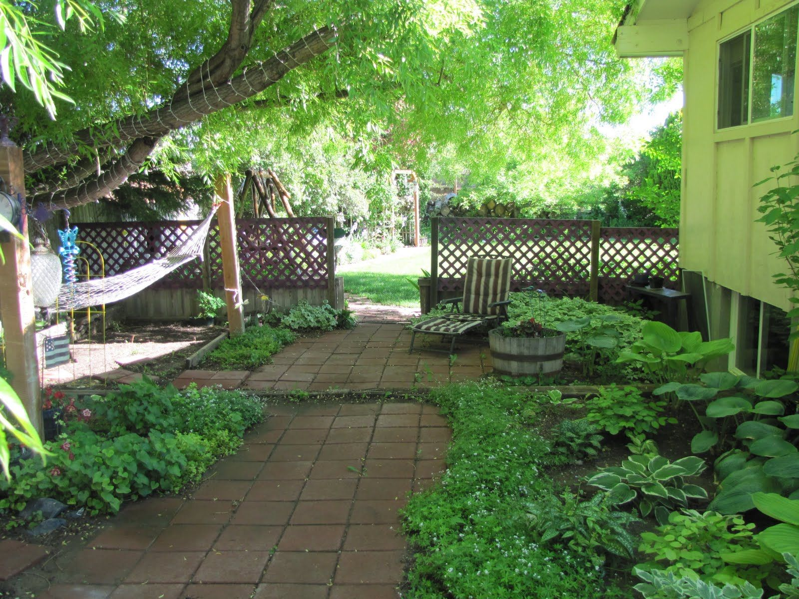 Porch and patio ideas love them description from for Landscape ideas for hilly backyards