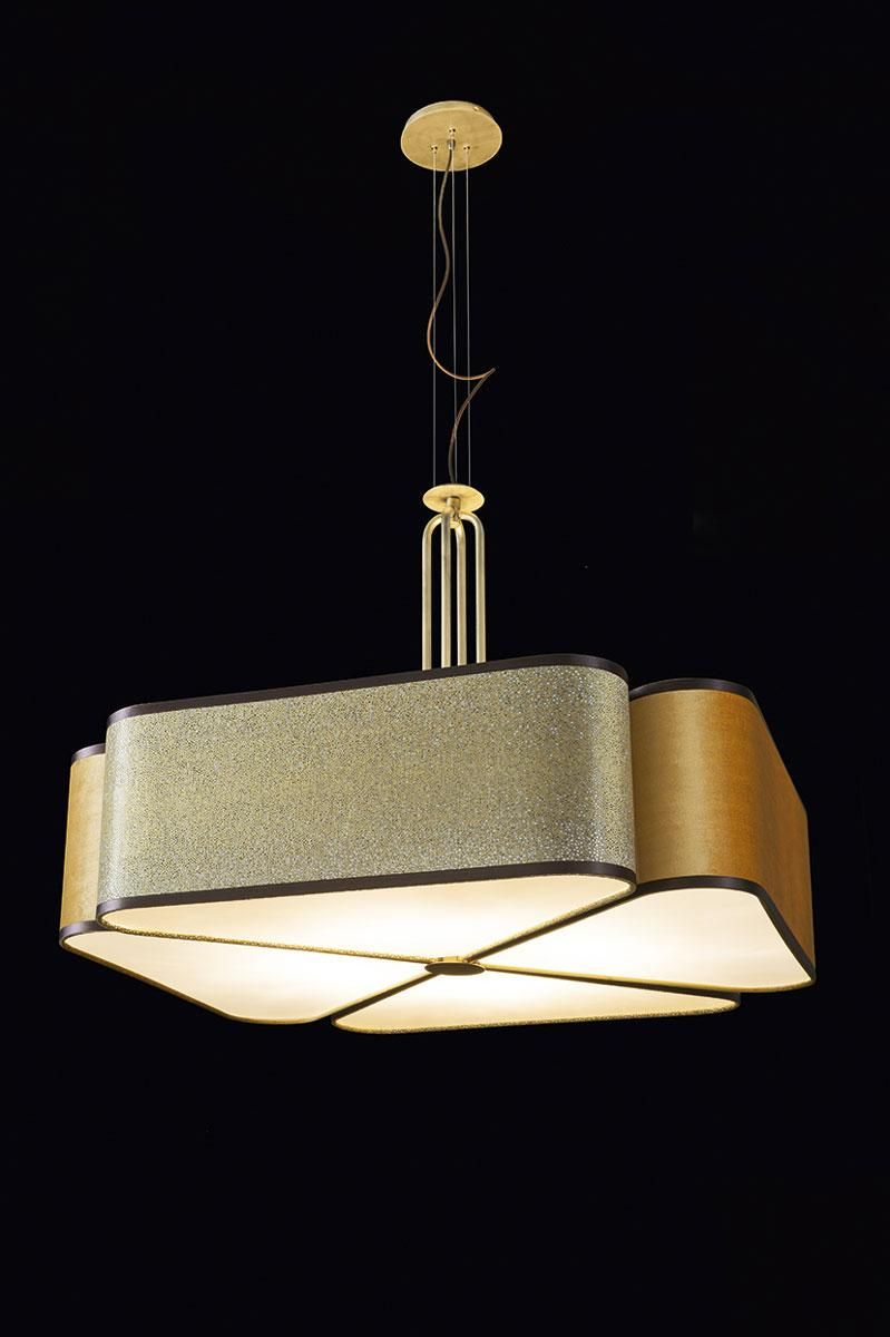"""The sheer, sumptuous finishings of cotton and velvet fabrics of """"Quadrifoglio"""" lighting collection play with the subtle four-leaf clover design and the satin finishings of the lampshade, to create an ambient of sophisticated, upscale class. The """"Quadrifoglio"""" hanging lamp comes with adjustable cables. Its Deluxe version sports a metal stem in antiqued gold finish."""