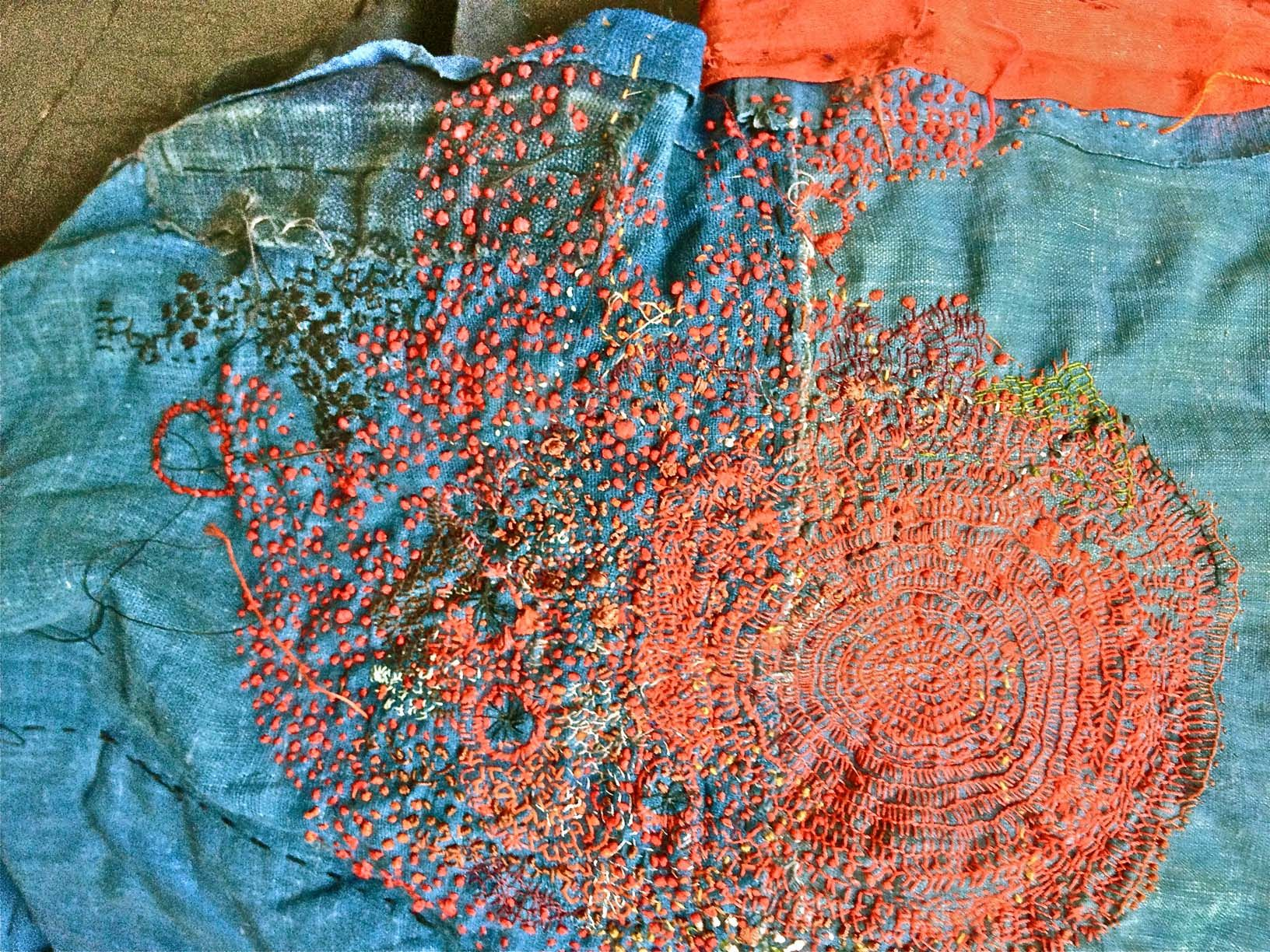 dots / junko oki I have begun to embroider on a light denim shirt using her colors and same stitches. I am having conceptual trouble with the blanket stitch..embroidering it in a spiral or circle with the spokes pointing out. It is pretty funny. I know I can do it. These are the brain hurdles I hoped I could reach. TaDAAA!