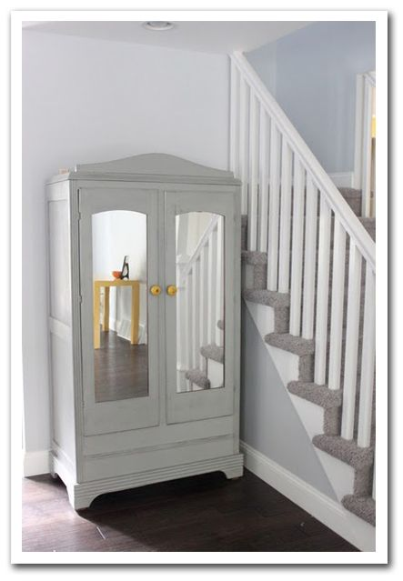 Armoire With Mirrors Near The Front Door Furniture