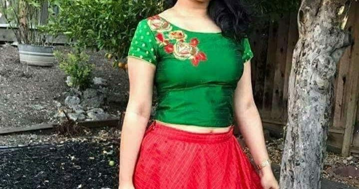 e8fc0f135ba Chanderi style material red umbrella style skirt with checks and paired  with dark green crop top, Boat neck design and short sleeves