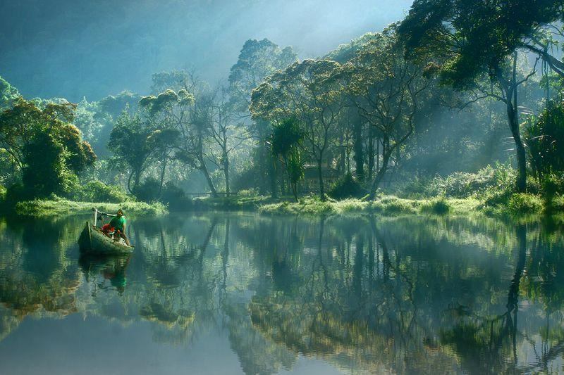 Morning reflections at Situ Gunung Lake, Java, Indonesia.