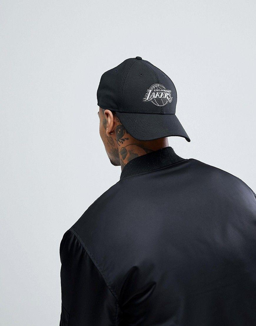 NEW ERA 9FORTY ADJUSTABLE CAP TONAL LA LAKERS - BLACK.  newera ... 5c2e303fefd