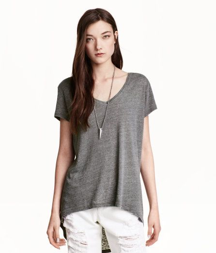 Check this out! V-neck top in jersey with short sleeves and rounded hem. Longer back section with seam. - Visit hm.com to see more.