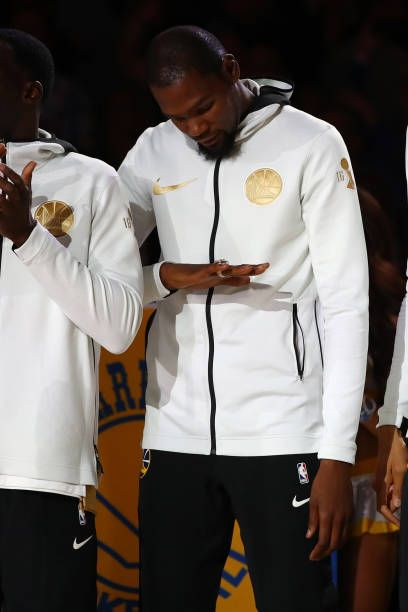 b33d8cef7a11 Kevin Durant of the Golden State Warriors looks at his2017 NBA Championship  ring prior to their NBA game against the Houston Rockets at ORACLE Arena.