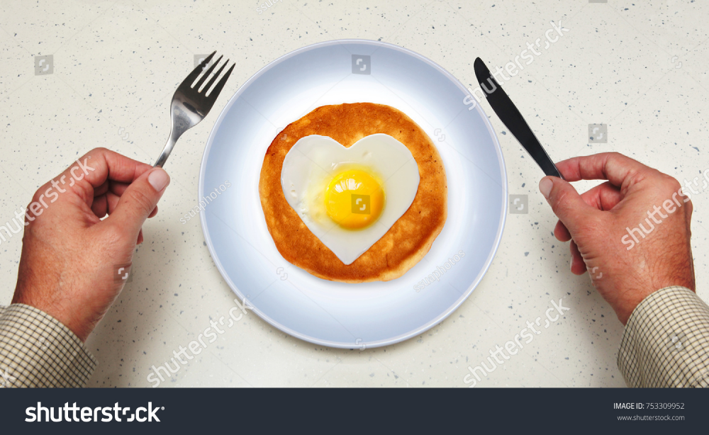 Hands Of Man And Scrambled Egg Royalty Free Images Stock Photography Heart Breakfast Buttermilk Carbohydrates Cre Scrambled Eggs Light Recipes Food L