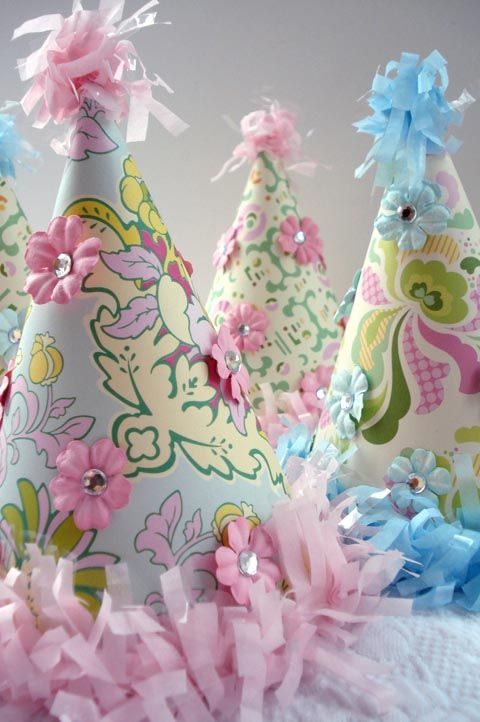 Make ugly old party hats fit you decor with scrapbook paper and a few embellishments