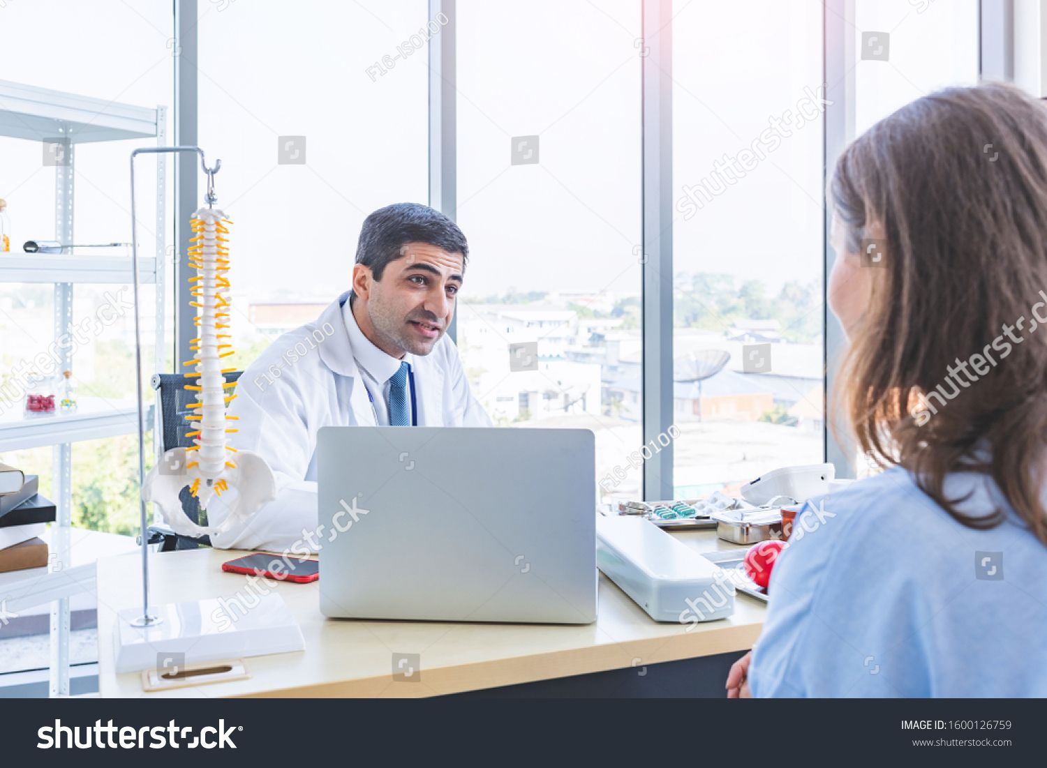 Serious Doctor Examining A Patient Obesity Royalty-Free