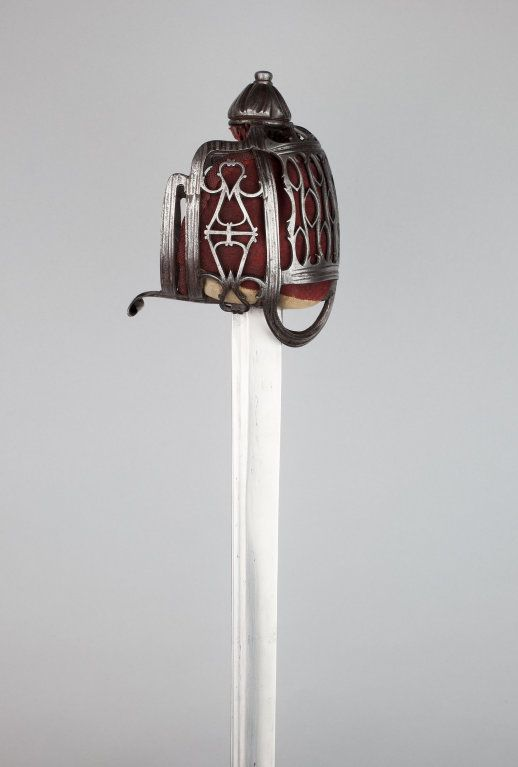 Walter Allan Scottish, Stirling, active 1732-1761 Basket-Hilted Broadsword (Claymore), c. 1750 Steel, iron, copper, leather, felt, fiber weave, wood and fish skin Overall L. 101.5 cm (39 7/8 in.) Blade L. 87 cm (34 1/4 in.) Wt. 2 lb. 14 oz.