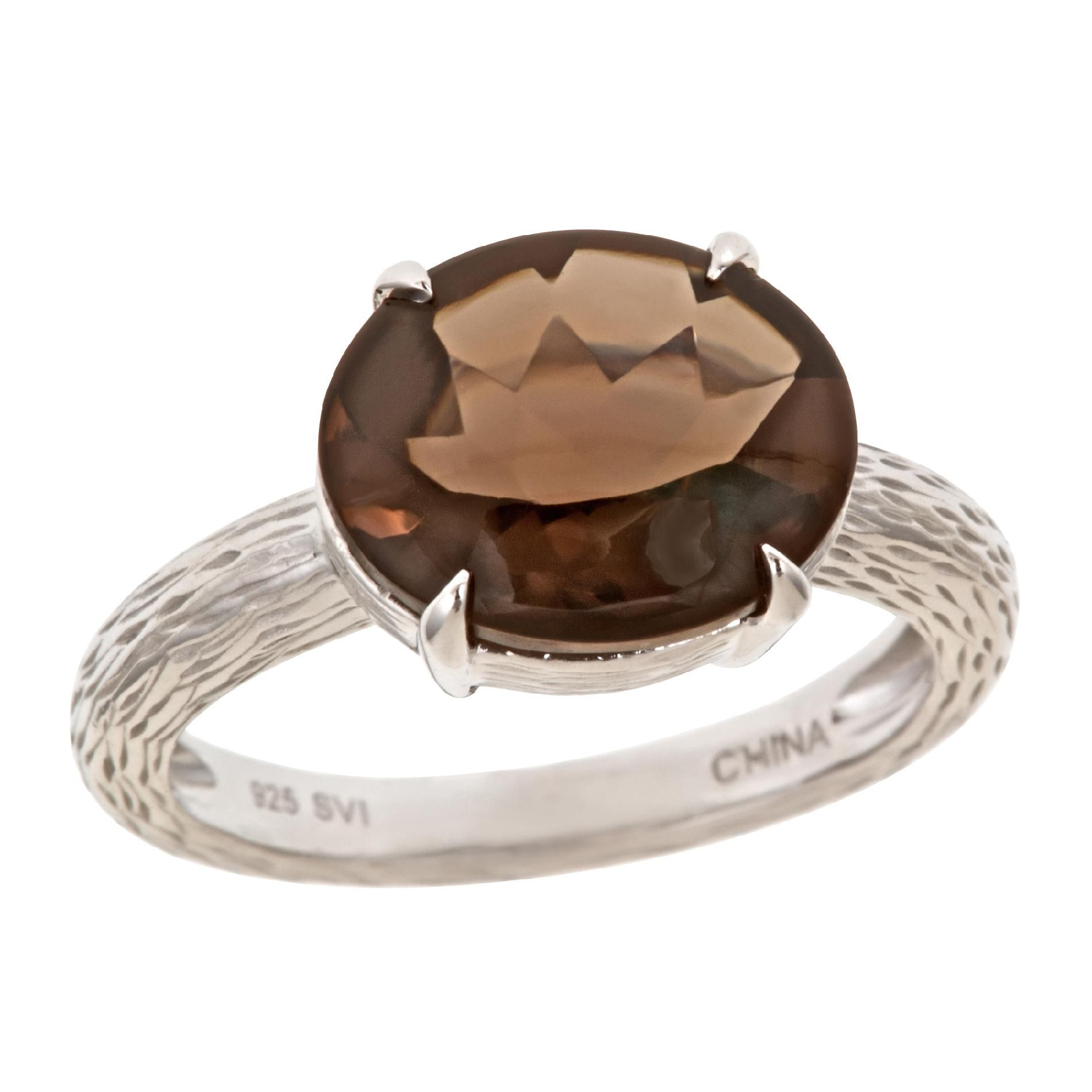 A sterling silver 12x10 oval gemstone ring with textured shank.