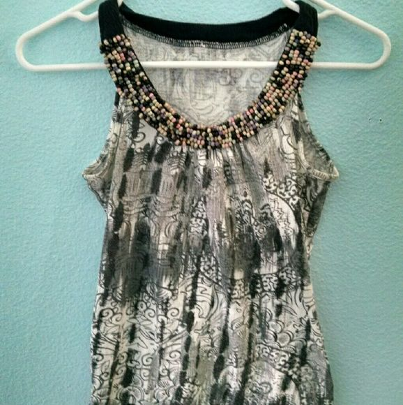 Beaded Tank top This tank top has an assortment of beads at the neckline. It is great for casual and more formal occasions. It is used and some of the beads are growing loose but it still is nice for many occasions. Tops Tank Tops