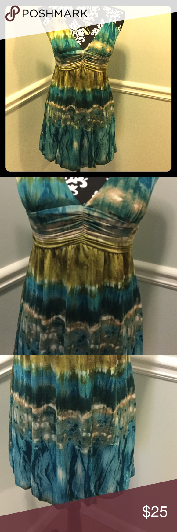 Watercolor sundress! Fun watercolor look fabric in shades of teal and green. Halter tie neck and balloon hem. Flattering gathered bodice. No zipper. Sweet dress! Trixxi Dresses Mini