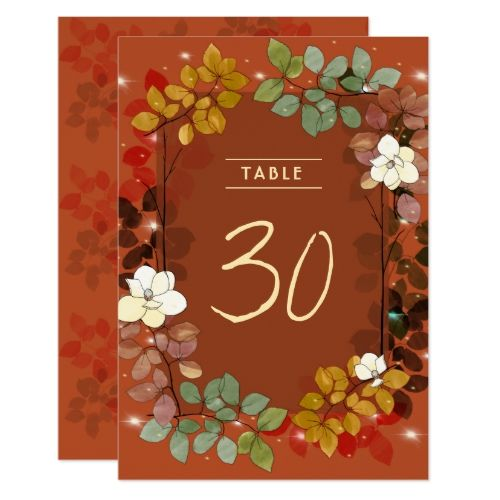 Fireflies and Magnolias Fall Garden Table Number is part of garden Table Yards - Digitally illustrated magnolias with autumn colored garden leaves with a few twinkles  Burnt rust orange background perfect for fall weddings
