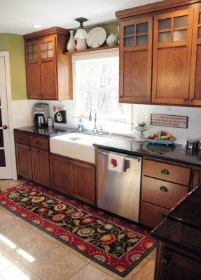Oak Cabinets Farmhouse Sink Stainless Steel Appliances And Black Countertop