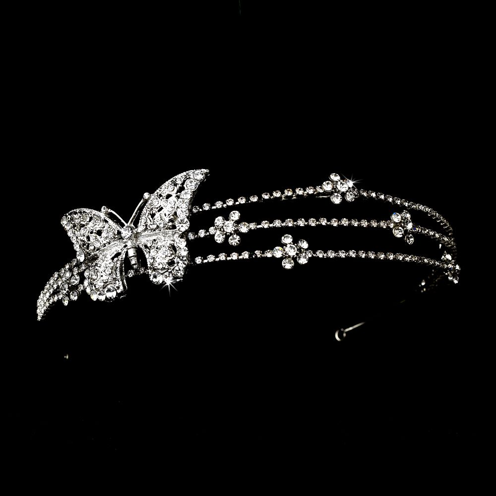 The Rhodium Silver Butterfly Headband Headpiece features a beautiful silver headband studded with sparkling rhinestones and a butterfly detail.