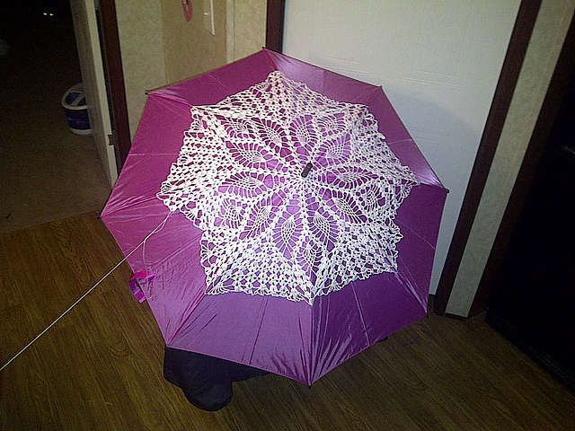 You can use a doily to dress up just about any item that you own. Here's an example of adding a doily to an umbrella. Found this one on Ravelry.