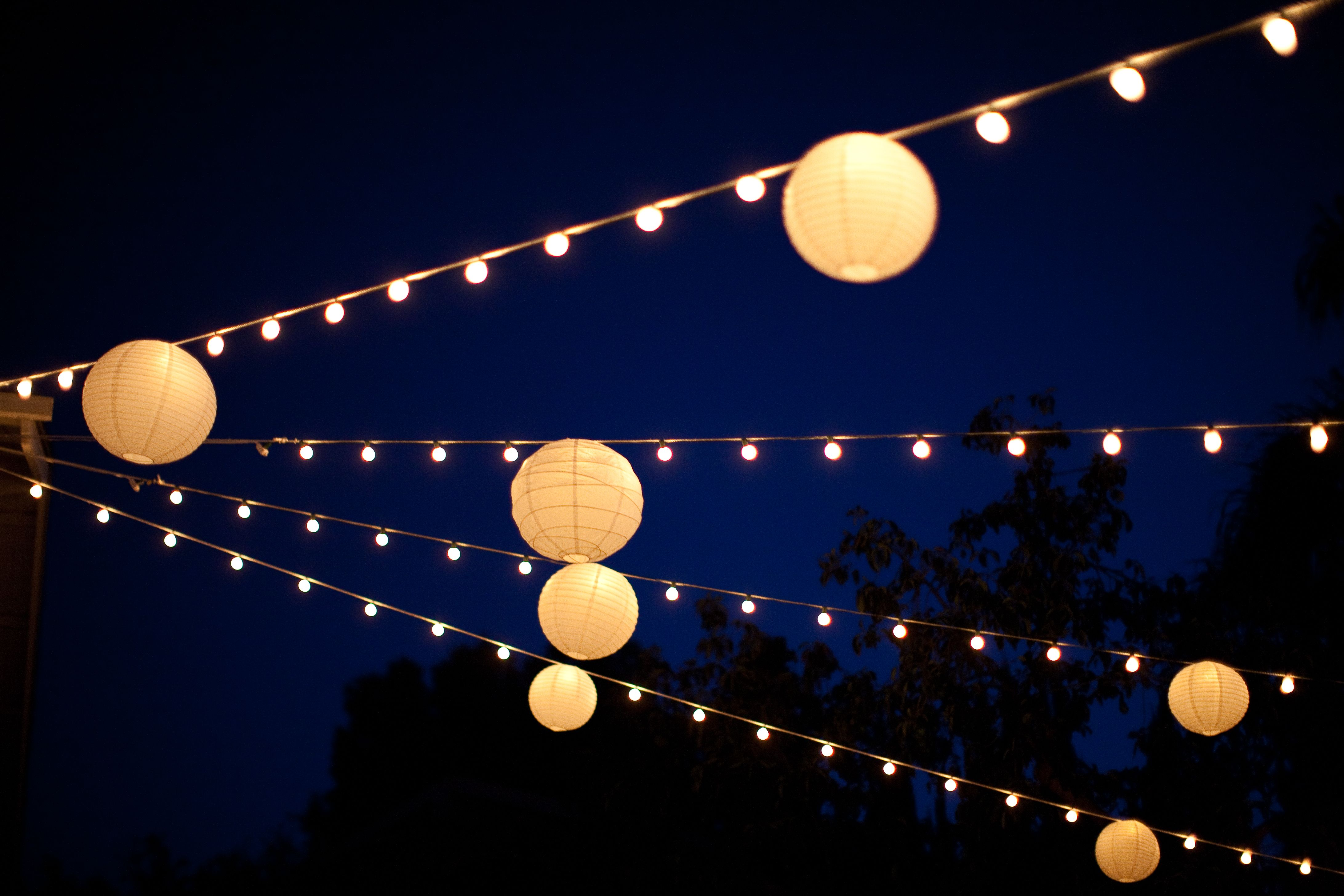 string lights and paper lanterns for a backyard wedding wedding