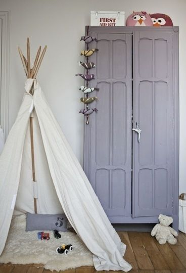 what a cute little hideout spot. love the hanging birds and painted armoire.