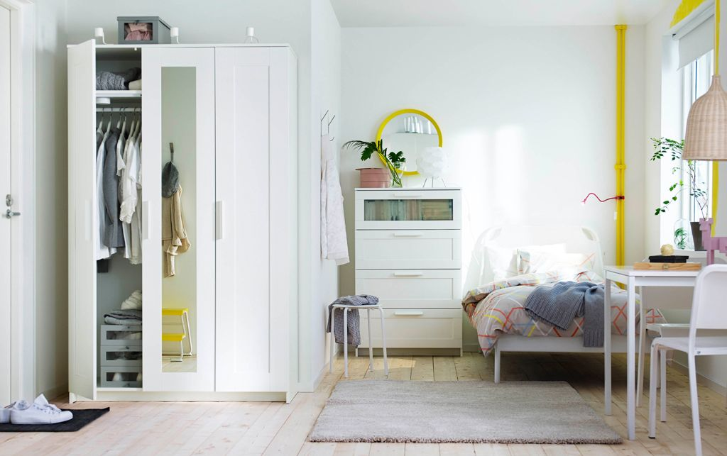 small apartment with wardrobe chest drawers bed table dvd storage ...
