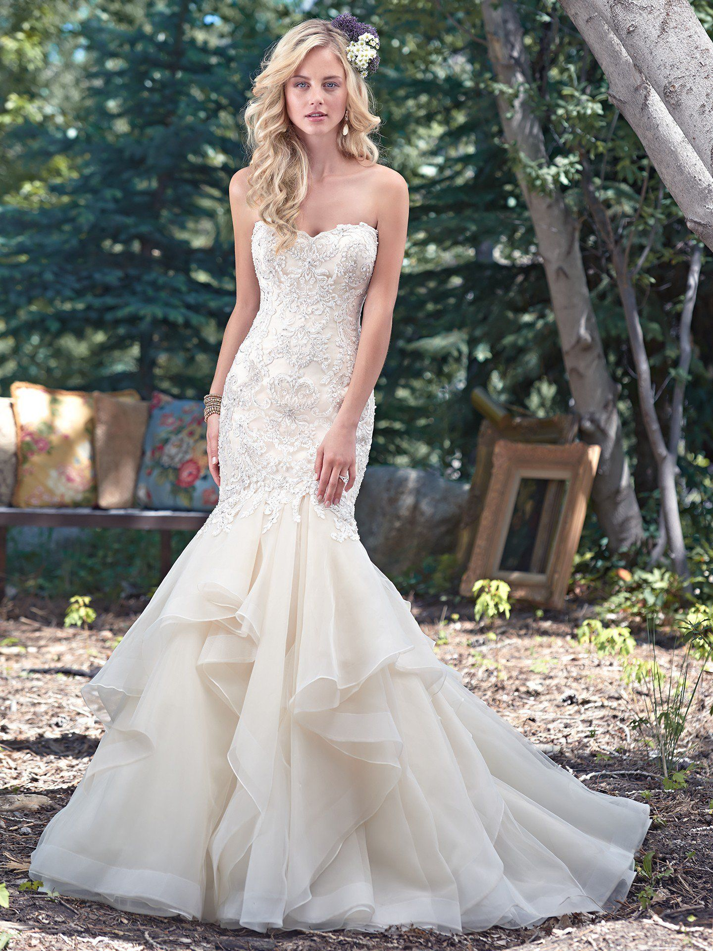 Understated drama is found in this fit and flare wedding dress with a  stunning fitted lace bodice d1b4fa636c3e