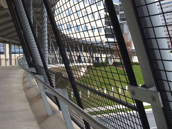 The Black Powder Coated Wire Mesh Fence Is Framed In A