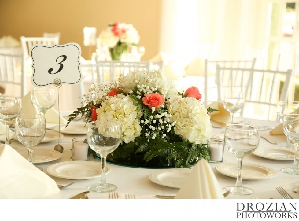 These center pieces were simply gorgeous with white hydrangeas and pink roses! #WinterWedding #Drozian #Photoworks