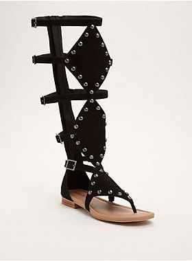 57663d138ae8  div  div Sandals that are worth fighting for. The knee-high pair is  gladiator-inspired with a black faux suede cage front that s toughened up  by studs ...