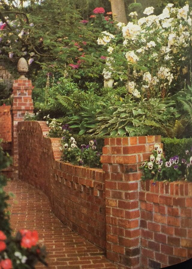 Brick retaining wall landscape design pinterest for Front garden brick wall ideas