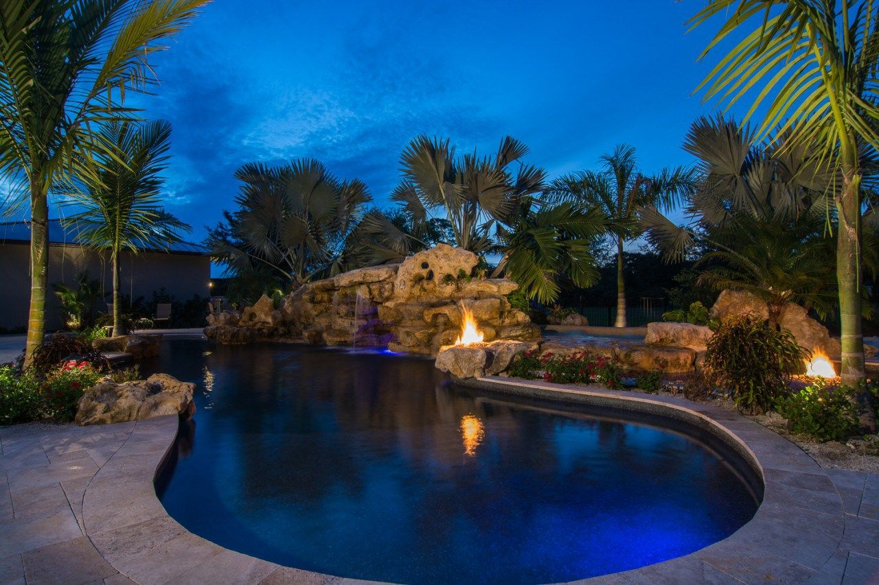 Natural Fire Pits And Spa Pool Waterfalls And Stone Waterfalls Grotto Natural Pool With Stone Fire Pits Ro Pool Landscaping Lagoon Pool Natural Swimming Pools