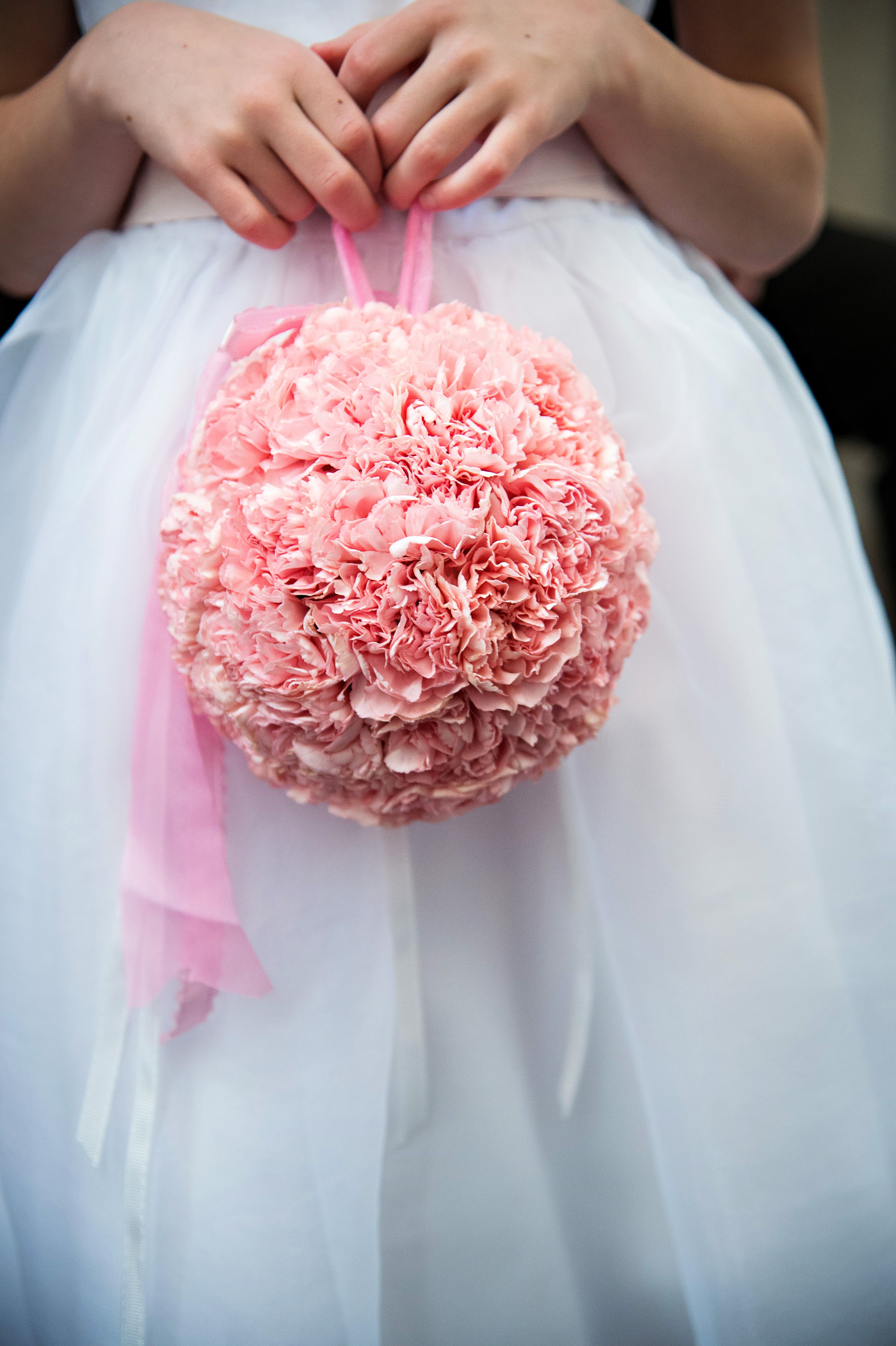 Pristine Pink Carnations Make A Beautiful Pomander For A Flower Girl