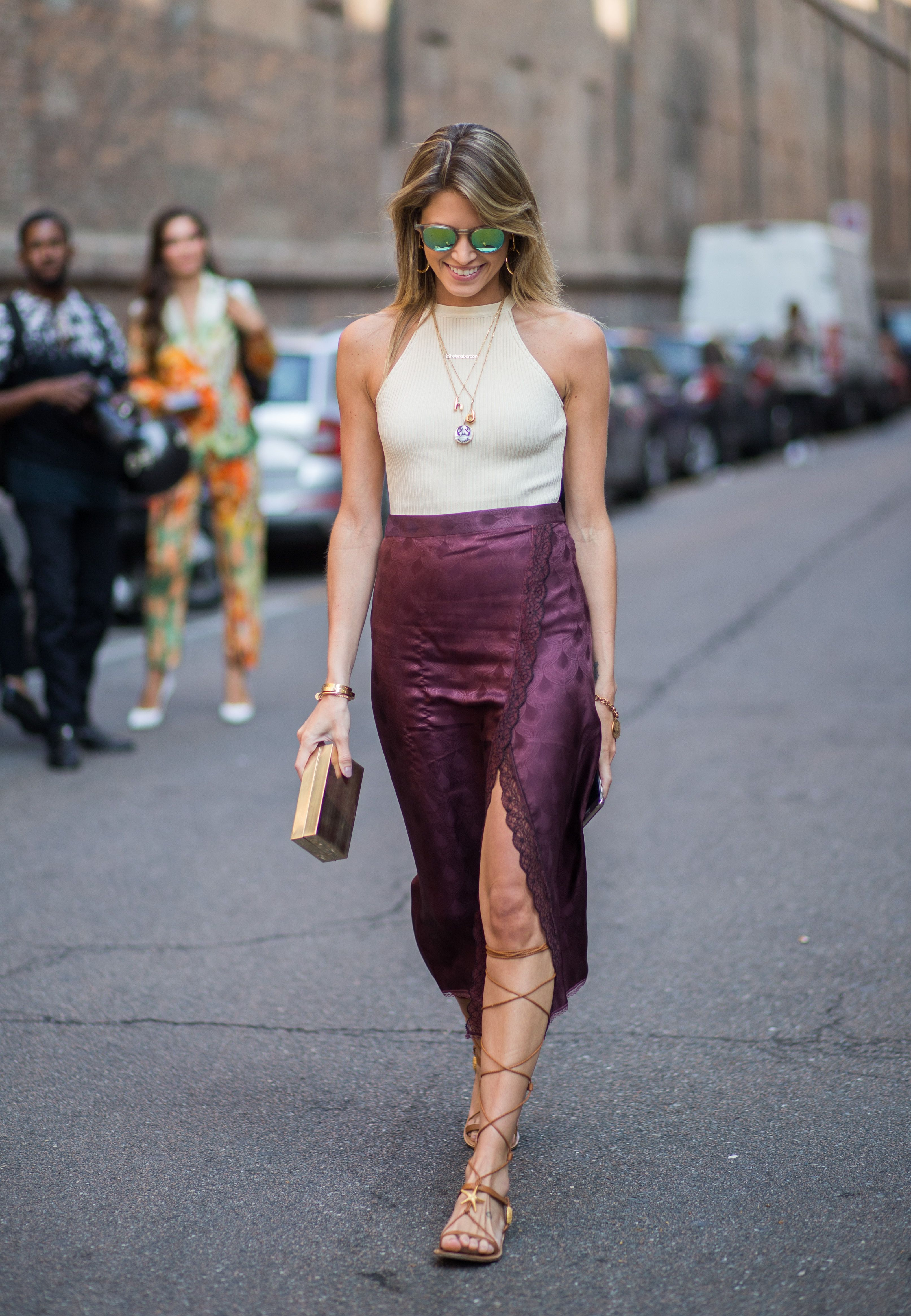 How to style a halter top courtesy of street style outfit inspiration from @Stylecaster   cream top, purple wrap skirt, gladiator sandals