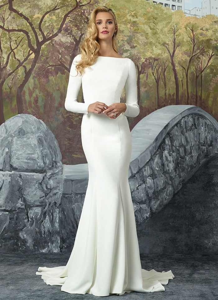 Turn heads with this crepe long sleeve fit and flare gown