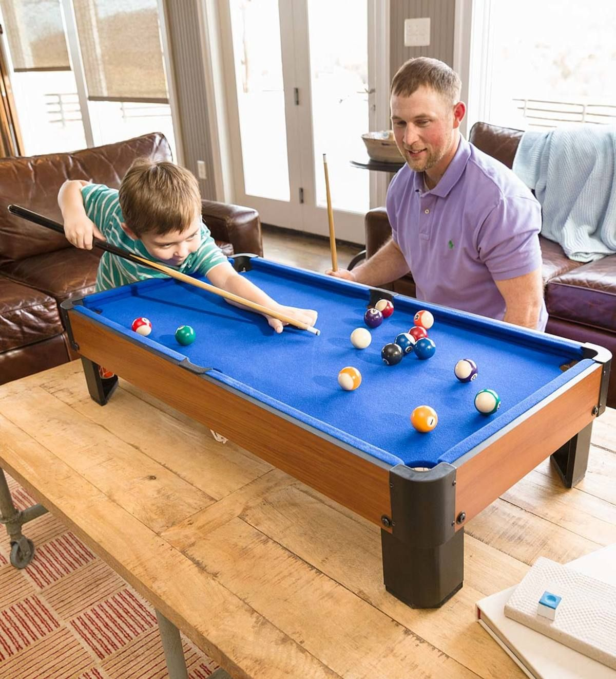 Play pool anywhere with this Tabletop Pool Set. All you