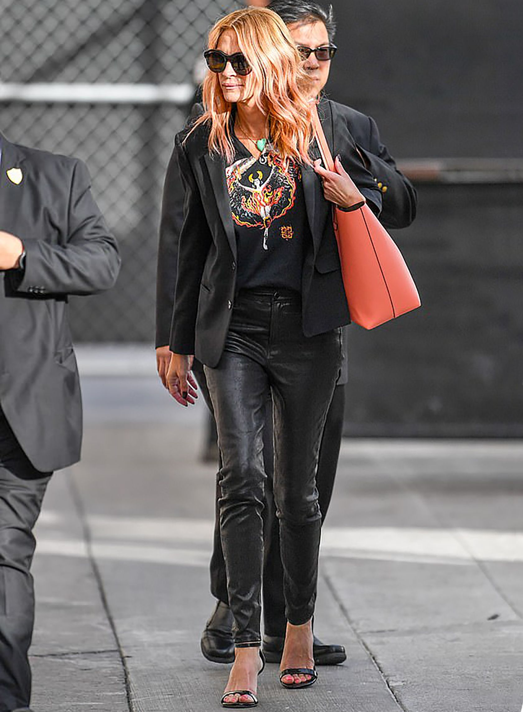 73e599469a8a Sydne Style shows how to dress like julia roberts in black leather pants  and blazer with graphic tee  juliaroberts  leather
