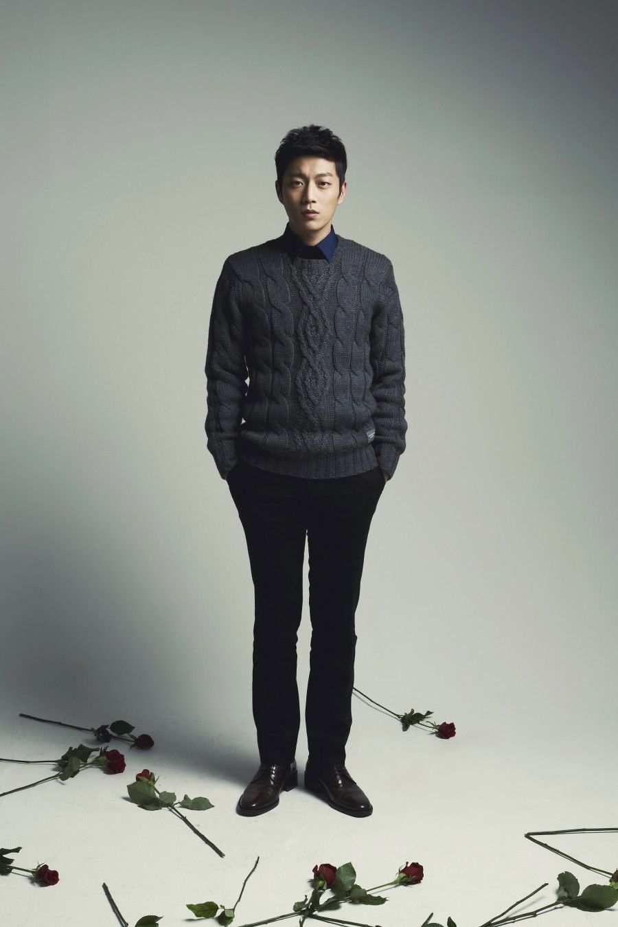 Yoon Du Jun Standing Between Flowers